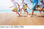 Купить «Close-up of running kids legs in shallow sea water», фото № 27059705, снято 20 июля 2017 г. (c) Сергей Новиков / Фотобанк Лори