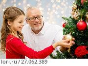 Купить «grandfather and granddaughter at christmas tree», фото № 27062389, снято 14 сентября 2014 г. (c) Syda Productions / Фотобанк Лори