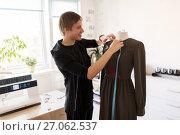 Купить «fashion designer with dummy making dress at studio», фото № 27062537, снято 28 июня 2017 г. (c) Syda Productions / Фотобанк Лори