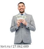 Купить «smiling businessman with american dollar money», фото № 27062689, снято 6 мая 2017 г. (c) Syda Productions / Фотобанк Лори