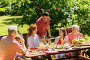 happy family having dinner or summer garden party, фото № 27062697, снято 9 июля 2017 г. (c) Syda Productions / Фотобанк Лори