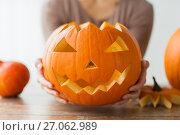 Купить «close up of woman with halloween pumpkin at home», фото № 27062989, снято 15 сентября 2017 г. (c) Syda Productions / Фотобанк Лори