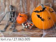 Купить «halloween pumpkins, skeleton and candies», фото № 27063005, снято 18 сентября 2017 г. (c) Syda Productions / Фотобанк Лори