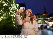 young woman taking selfie over christmas tree. Стоковое фото, фотограф Syda Productions / Фотобанк Лори