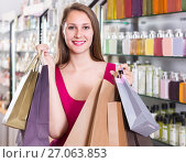 Купить «woman displaying shopping bags with purchase in the natural cosmetics shop», фото № 27063853, снято 2 мая 2017 г. (c) Яков Филимонов / Фотобанк Лори