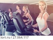 Купить «Slender athletic girls running on treadmill in fitness club», фото № 27064117, снято 26 июля 2017 г. (c) Яков Филимонов / Фотобанк Лори