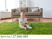 Купить «baby boy on floor and eating rice cracker at home», фото № 27066489, снято 19 мая 2017 г. (c) Syda Productions / Фотобанк Лори