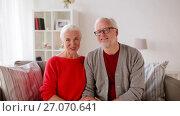 Купить «senior couple recording video greeting», видеоролик № 27070641, снято 20 сентября 2017 г. (c) Syda Productions / Фотобанк Лори