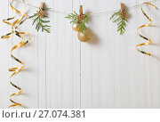 Купить «Christmas decorations on white wooden background», фото № 27074381, снято 6 октября 2017 г. (c) Майя Крученкова / Фотобанк Лори