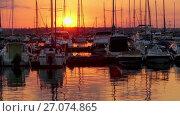 Купить «Yachts and ships against backdrop of sunset», видеоролик № 27074865, снято 15 октября 2016 г. (c) BestPhotoStudio / Фотобанк Лори