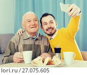 Купить «Elderly father and son doing selfie», фото № 27075605, снято 16 августа 2018 г. (c) Яков Филимонов / Фотобанк Лори