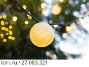 close up of christmas tree garland bulb outdoors. Стоковое фото, фотограф Syda Productions / Фотобанк Лори