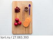 Купить «fruit puree or baby food in jar and feeding spoon», фото № 27083393, снято 21 февраля 2017 г. (c) Syda Productions / Фотобанк Лори