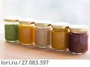 Купить «vegetable or fruit puree or baby food in jars», фото № 27083397, снято 21 февраля 2017 г. (c) Syda Productions / Фотобанк Лори