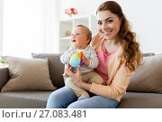 Купить «happy young mother with little baby at home», фото № 27083481, снято 19 мая 2017 г. (c) Syda Productions / Фотобанк Лори