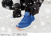 Купить «close up of man tying shoe lace in winter outdoors», фото № 27083521, снято 10 ноября 2016 г. (c) Syda Productions / Фотобанк Лори