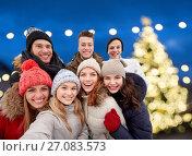 Купить «happy friends taking selfie outdoors at christmas», фото № 27083573, снято 19 января 2015 г. (c) Syda Productions / Фотобанк Лори