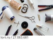 Купить «scissors, hairdryers, irons and brushes», фото № 27083681, снято 12 апреля 2017 г. (c) Syda Productions / Фотобанк Лори