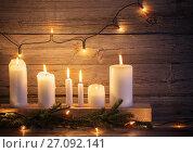 Купить «Christmas candles on wooden background», фото № 27092141, снято 13 ноября 2016 г. (c) Майя Крученкова / Фотобанк Лори
