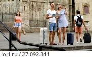 Купить «Smiling couple man and woman going the historic center with map and baggage», видеоролик № 27092341, снято 5 июля 2017 г. (c) Яков Филимонов / Фотобанк Лори