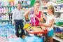 Young family with kid are choosing goods, фото № 27093857, снято 11 июля 2017 г. (c) Яков Филимонов / Фотобанк Лори