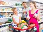 Smiling young woman and man with child choosing yogurt, фото № 27093865, снято 11 июля 2017 г. (c) Яков Филимонов / Фотобанк Лори