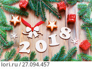 Happy New Year 2018 background with 2017 figures, Christmas toys, green fir tree branches. New Year 2018 still life, фото № 27094457, снято 29 ноября 2016 г. (c) Зезелина Марина / Фотобанк Лори