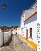 Купить «Cozy narrow paved streets with white houses inside the old city walls of Mertola. Beja. Portugal», фото № 27094609, снято 30 июня 2016 г. (c) Serg Zastavkin / Фотобанк Лори