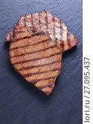 Купить «Close-up of marbled beef striploin steak», фото № 27095437, снято 2 октября 2017 г. (c) Oksana Zh / Фотобанк Лори