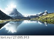 Купить «Reflection of Matterhorn in lake, Zermatt, Switzerland», фото № 27095913, снято 11 сентября 2017 г. (c) Iakov Kalinin / Фотобанк Лори