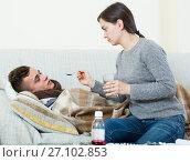 Купить «Concerned mother giving mixture to son with quinsy», фото № 27102853, снято 21 апреля 2019 г. (c) Яков Филимонов / Фотобанк Лори