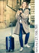 Купить «Girl holding camera in hands and photographing in the city», фото № 27106781, снято 27 марта 2017 г. (c) Яков Филимонов / Фотобанк Лори