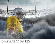 Купить «american football player in stadium with smoke», фото № 27109125, снято 16 октября 2018 г. (c) Wavebreak Media / Фотобанк Лори