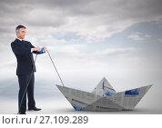 Купить «Businessman pulling paper boat», фото № 27109289, снято 20 февраля 2018 г. (c) Wavebreak Media / Фотобанк Лори