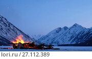 Купить «Bonfire on the ice of Lower Multinskoe lake in the Altai Mountains at late evening with snow on mountains», видеоролик № 27112389, снято 18 октября 2017 г. (c) Serg Zastavkin / Фотобанк Лори