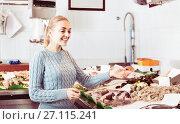 Купить «Woman selecting fish at fishery», фото № 27115241, снято 17 ноября 2019 г. (c) Яков Филимонов / Фотобанк Лори