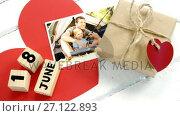 Купить «Wooden cubes with date 18 June and gifts 4k», видеоролик № 27122893, снято 20 марта 2019 г. (c) Wavebreak Media / Фотобанк Лори