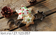 Купить «Christmas cookies and cookie cutters on wooden table 4k», видеоролик № 27123057, снято 9 июля 2020 г. (c) Wavebreak Media / Фотобанк Лори