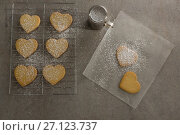 Купить «Raw heart shape cookies on baking tray with flour shaker strainer and wax paper», фото № 27123737, снято 5 мая 2017 г. (c) Wavebreak Media / Фотобанк Лори