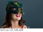 Купить «Woman wearing masquerade mask against black background», фото № 27126229, снято 22 мая 2017 г. (c) Wavebreak Media / Фотобанк Лори