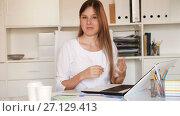 Купить «Smiling young businesswoman politely welcoming to company office», видеоролик № 27129413, снято 9 августа 2017 г. (c) Яков Филимонов / Фотобанк Лори