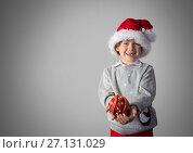 Купить «Boy against grey background with Santa hat and Christmas clothes», фото № 27131029, снято 21 сентября 2018 г. (c) Wavebreak Media / Фотобанк Лори
