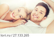Купить «happy couple lying in bed at home», фото № 27133265, снято 25 февраля 2016 г. (c) Syda Productions / Фотобанк Лори