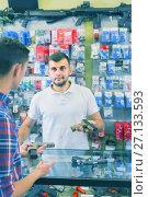 Купить «guy haelping customer to choose handgun in army market», фото № 27133593, снято 4 июля 2017 г. (c) Яков Филимонов / Фотобанк Лори