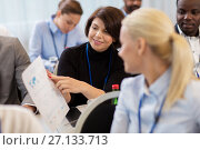 Купить «business people at conference with papers», фото № 27133713, снято 27 августа 2017 г. (c) Syda Productions / Фотобанк Лори