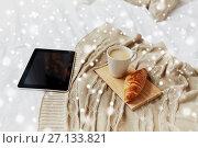 Купить «tablet pc, coffee and croissant on bed at home», фото № 27133821, снято 15 октября 2016 г. (c) Syda Productions / Фотобанк Лори