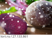 Купить «close up of sliced beet on wood», фото № 27133861, снято 5 августа 2016 г. (c) Syda Productions / Фотобанк Лори