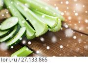 Купить «close up of celery stems and sliced cucumber», фото № 27133865, снято 5 августа 2016 г. (c) Syda Productions / Фотобанк Лори