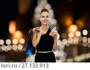 Купить «woman with credit card and shopping bags», фото № 27133913, снято 1 июня 2014 г. (c) Syda Productions / Фотобанк Лори