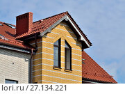 Купить «Attic windows on tile roof», фото № 27134221, снято 17 августа 2017 г. (c) Сергей Трофименко / Фотобанк Лори